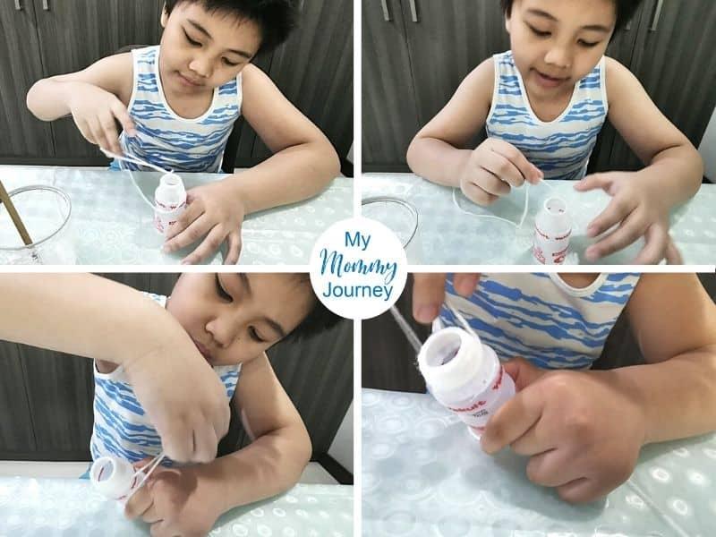 putting yarn on Yakult bottle craft