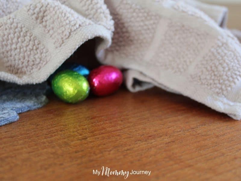Unique Easter Egg Hunt at Home for Kids hiding Easter eggs under towels